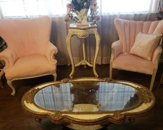 several vintage pink velvet side chairs, gold coffee table