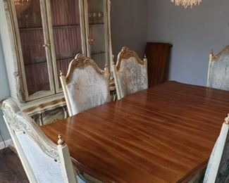 Ice blue vintage velvet chairs, seating for 6. Pink lined china cabinet.