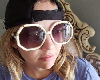 Emily wearing giant 70's sunglasses