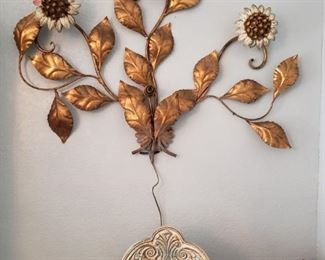 I love this large sconce, the flowers light up!