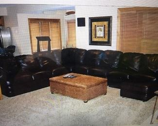 Black leather sectionals with Ottoman   Fabulous like new . Original cost $5500.-  Now $2500