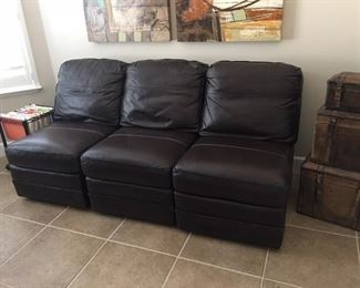 Arm less leather sectional chairs. May placed together or scattered individually  $1000