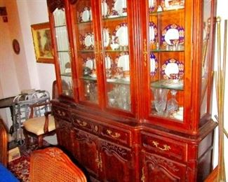 Mahogany Hutch with matching 8 wicker back matching  chairs and  table plus x-tender.