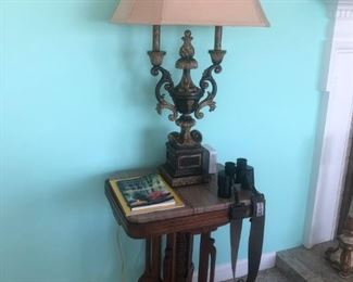 Antique Eastlake table with marble top.  Pair of double stylized arm urn lamps.