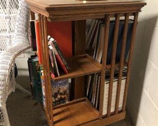 Antique Oak rotating on rolling feet book shelf