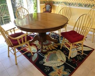 "54"" diameter kitchen table - $200  with 4 painted yellow side chairs - $30 each and 2 painted yellow captains chairs - $40 each"