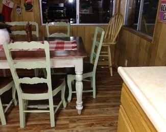 Large solid wood farm table 6 chairs and a bench.