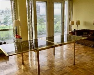 Milo Baughman Gold-Lacquered and Smoked Glass Extending Dining Table. *Shown opened