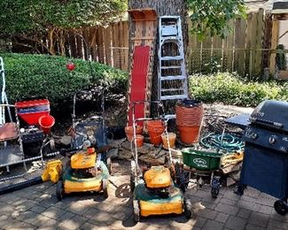Simplicity chipper, Echo weed whacker, leaf blower, Yardman 6hp lawn mower, 5 piece table set, glass and clay pots, Maxfire gas grill, step ladders