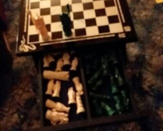Cess table with chess pieces