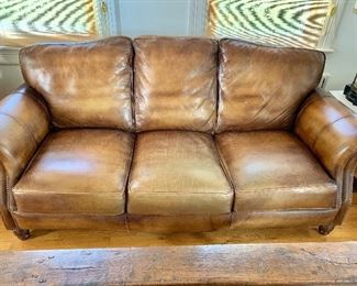 """$550 Leather, hobnailed sofa: 80"""" W, 39"""" D, 34"""" H."""