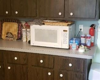 Microwave oven; sturdy wood cabinets are perfect for a garage or man cave