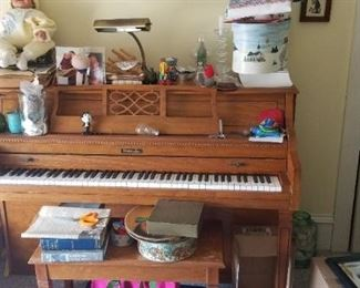 Baldwin upright piano located on ground floor for easy removal