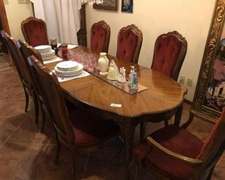 Beautiful dinner table with chairs.