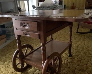 """Vintage rolling tea/serving  cart made in Japan; has 3 drawers and drop leaf  measures approximately 30 x 40"""" went open"""