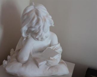 1.  marble  child  by  Emilo  Flaschi- 1901  It  comes  with  the  pedestal.  There  is  some  damage  on the  piece.