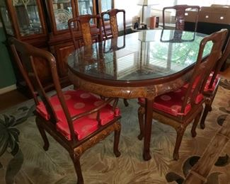 Engraved dining room table and 6 engraved chairs. 1000.00 or best offer. Call with any questions