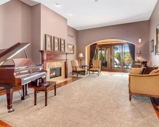 Plainfield Home Piano Room.  We are selling the fabulous Essex (Steinway designed and serviced) Baby Grand piano, the two chairs and table, the art above fireplace, the sofa and a side cabinet, and there is more info about these pieces as you scroll down