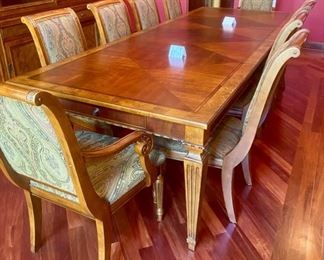 Lot 1501 Asking $4,250.00  Ethan Allen Townhouse Dining Table Shown with 2 Leaves and 10 Adison Chairs (by the way, that is the correct spelling of the chairs, too). Look at that gorgeous wood!  This is a future antique that will be used by your grandkids grandchildren and then some.  Also table has two pullout drawers, one on either side.  Cool.