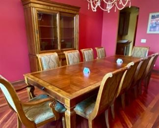 Lot 1501 Asking $4,250.00 OBO Gorgeous Ethan Allen Townhouse Line Dining Table with 2 Leaves and 2 Adison Arm Chairs & 8 side Chairs in addition to the Townhouse China Hutch/Buffet.  Sliding Cabinet Doors on the base, a lit top for showing off your treasures,  and custom pads for the table.The table is nicely framed with burled wood around the perimeter.  You can feed a throng sitting at this table - the chairs are still being sold at Ethan Allen, and these are upholstered with a premium fabric.  Perfect Shape, ready to entertain.