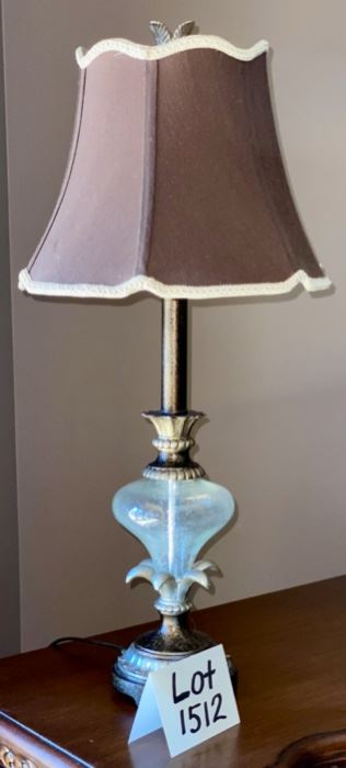 "Lot 1512  $40.00  Table Lamp with A Glass Bulb on Stem and Brown with Tan Fringe on Shade. 26.5"" H"