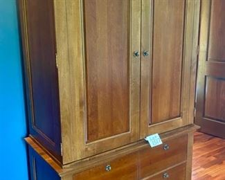 "Lot 1517  $900.00. Beautiful ""Marquette"" Wardrobe by Virginia Sterling from Tom's Price, with lots drawers to keep organized and 2 Drawers on the Bottom of Cabinet. Orig. Pd $2917.00.  43.25"" W x 24"" D by 78"" H."