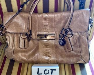 Lot 1521 $65.00. Authentic Coach Pebble Leather with Snake Skin treatment in the center of the bag. 2 Handles, plus removable shoulder strap. Excellent Condition, Official Coach Fob and Leather Tag. Front Flap with interesting metal closure, and handy Inside Zipper Compartments.   Perfect for Fall!