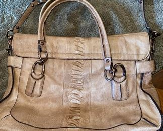 Lot 1521 $65.00.   Opposite side Authentic Coach Pebble Leather with Snake Skin treatment in the center of the bag. 2 Handles, plus removable shoulder strap. Excellent Condition, Official Coach Fob and Leather Tag. Front Flap with interesting metal closure, and handy Inside Zipper Compartments.   Perfect for Fall!