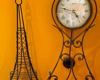 "Lot 1526  $ 40.00 Metal Eiffel Tower Art and Clock with Pendulum and White Face.  Battery Operated.  Tower: 26.5"" T x 12"" W  Clock: 28.5"" T x 11"" W"