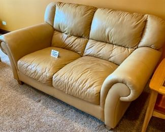 "ot 1535  $400.00  Matching Tan Leather 2 Cushion Love Seat with Rolled Arms and Attached Comfy Cushions in Great Shape and Color.  69"" L x 40"" H Seat Back x 38"" D, Cushion 24"" D x 17"" H to Seat Cushion."