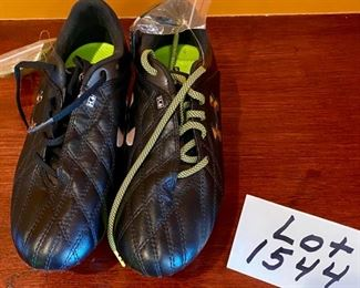 Lot 1544. $20.00.  Like-New Pair of Under Armor Cleats USA Size 6  Euro Size 38.5.  Our clients' daughter did play soccer for a Big 10 Team, so they picked her cleats wisely!