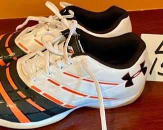 "Lot 1545. $18.00  Pair of Under Armor ""Man Mapper"" Athletic Shoes with Orange Stripes, Scuff marks Visible. USA Size 7"