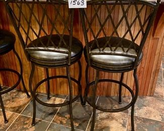"Lot 1563. $180.00.   Set of two Premier  30"" Atrium Rounded Swivel Bar Stools made of Wrought Iron with Full Back Support, Interwoven Lattice Pattern Back in Autumn Rust Finish and Coffee Colored Vinyl Upholstery. 30"" H Seat, 18"" Diameter Seat, 46"" H on Back Rest"