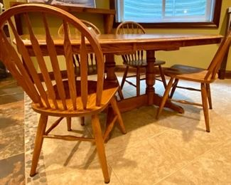 "LLot 1564  $275.00  Solid  Oak Kitchen Table w/ Under Table Leaf Storage and 4 Oak Spindle Back Chairs.  Great for a Growing Family. Includes 1 Leaf.  49.5"" L w/o Leaf x 34"" W,  Leaf is 17.75"" W.  Shown with Leaf 00"