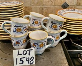 Lot 1548  $250.00   (Retails for $560.00)  Sur La Table Nova DeRuta Pottery Dinnerware service for almost 8 - includes 7 dinner plates and 8 mugs (one not shown),, 8 salad and 8 soup plates.  Serving pieces sold separately,  Microwave safe  hand-crafted in Italy.  Retails for $560  Asking $250. Classic good looks.