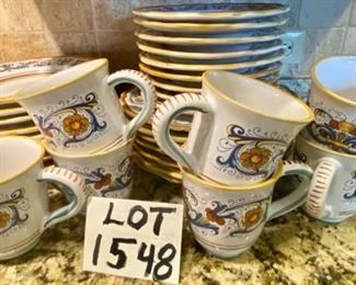 Lot 1548  $250.00   Note the silverware marks on this plate - you can scrub lightly with soft scrub or Bon Ami  to remove.  (The set Retails for $560.00)  Sur La Table Nova DeRuta Pottery Dinnerware service for almost 8 - includes 7 dinner plates and 8 mugs (one not shown),, 8 salad and 8 soup plates.  Serving pieces sold separately,  Microwave safe  hand-crafted in Italy.  Retails for $560  Asking $250. Classic good looks.