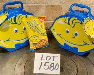 "Lot 1580. $15.00. Two ""Lemonhead"" Metal Lunch Boxes, plus one unopened bag of Lemonhead Candy (for decor - candy expired in 2012!) Never used, Cute!"