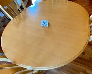 "Lot 1566 $375.00  Bassett Round Table w/ 4 Cabriole Legs Kitchen Table and Matching Chairs plus One 12"" Leaf (shown in either Maple or Birch.  The next lot is a match for this table. Very Attractive piece. Table: 48"" Diameter + 12"" Leaf, Chairs: 40"" H x 18"" D x 19"" W Seat and 17.5"" H Orig. Pd over $1400.00,"