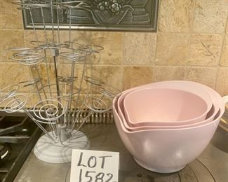Lot 1582  $30.00  Wilton Wire Cupcake Holder, so cute, and Melamine Mixing Bowl Set of 3 from Williams-Sonoma, in pink.  Smallest size has hairline crack in middle, still holds liquid so should be functional - everything else is terrific.  Darling Set, with stoppers on the bottom of each bowl so they don't skid around while using.