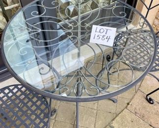 Lot 1584 $150.00  Wrought Iron Bistro Table with Glass Top and 2 Wrought Iron Chairs