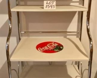 "Lot 1595  $175.00. Attention Coca Cola Collectors!  Coca-Cola Collector's Stand, Chrome Metal Frame, Coated Composite Shelves."" 65"" T x 25"" W x 19""D.  5 shelves, 2 shelves are 12""D"