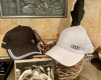 Lot 1614 $28.00. 4 piece Lot includes a Pair of the Audi Baseball Caps, Framed Photo Decor and Umbrella. We also have 2 Sets Audi Q3 Floor Mats (Never Used)
