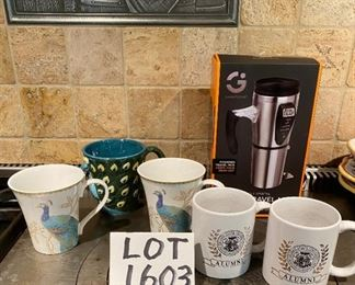 Lot 1603.  Asking $28.  Smart Gear Heated Travel Mug, New in Box, 2 Mugs Alumni from Truman State University, 1 Cool Peacock Shaped mug in relief, and 2 Peacock decorated mugs