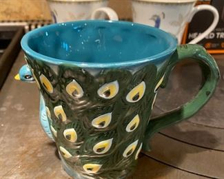 Lot 1603.  Asking $28 for all. Smart Gear Heated Travel Mug, New in Box, 2 Mugs Alumni from Truman State University, 1 Cool Peacock Shaped mug in relief, and 2 Peacock decorated mugs