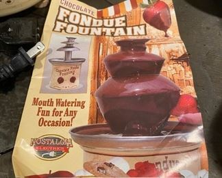 Lot 1604. The best $30 you will ever spend!  Yum!  Kids and Grandkids love this!  Chocolate Fondue Fountain by Nostalgia Electrics