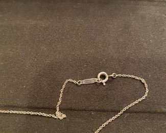"Lot 1607-A.   Asking $150.   Tiffany & Company necklace; 16"" and Sterling Silver pendant has company name engraved in script"