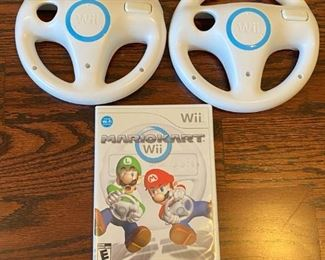 "Lot 1646.   $100.00 ""The Wii Bundle"": Wii Game Console, 2 Remote Controller, 2 Nunchucks, Mario Kart with 2 Wheels and Game, Wii Sports, Resort Sports Games and 2 Extra Battery Packs plus Nyko Battery Charger.		$100.00"""