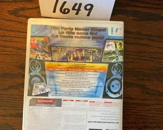 "Lot 1649.   $35.00.    2 Konami Dance Pads and""Hottest Party 2"" by Dance Dance Revolution (DDR) Game"