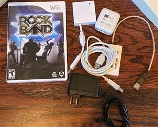 Lot 1650.  $100.00.  Wii Rock Band Drum Set and Game, Rock Band Microphone with Wii Sing Game, Rock Band Guitar with 3 Guitar Hero Games.  Nice Lot!