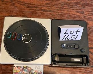 Lot 1651. $30.   Wii DJ Hero TurnTable and Wii DJ Hero Game.